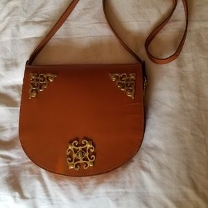 Camel cross body leather bag with brass closure
